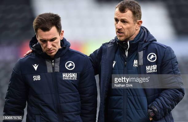 Gary Rowett of Millwall FC talks to Jed Wallace of Millwall FC during the Sky Bet Championship match between Derby County and Millwall at Pride Park...