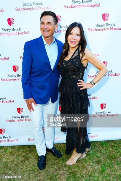 Gary Rumbough and Jane Scher attend the Annual Summer Party Benefiting Stony Brook Southampton Hospital on August 03 2019 in Southampton New York