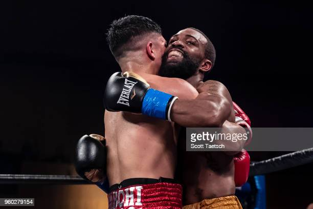 Gary Russell Jr and Joseph Diaz Jr embrace at the end of their WBC featherweight title bout at MGM National Harbor on May 19 2018 in Oxon Hill...