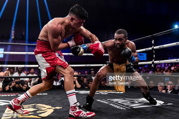 Gary Russell Jr and Joseph Diaz Jr trade punches during the 12th round of the WBC featherweight title bout at MGM National Harbor on May 19 2018 in...