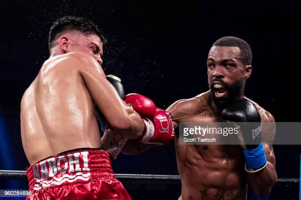 Gary Russell Jr punches Joseph Diaz Jr during the fourth round of the WBC featherweight title bout at MGM National Harbor on May 19 2018 in Oxon Hill...