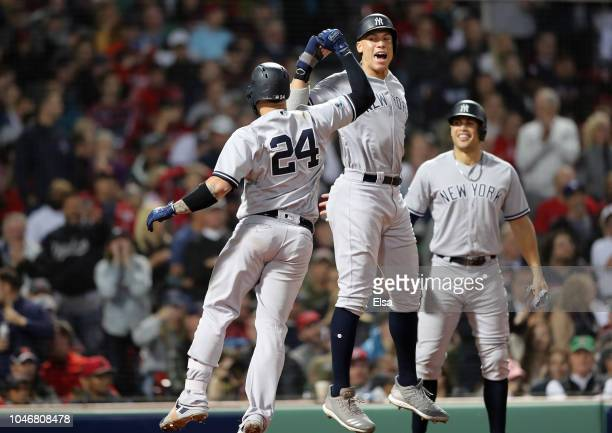 Gary Sanchez and Aaron Judge of the New York Yankees celebrate after Sanchez hit a threerun home run as teammate Giancarlo Stanton watches during the...
