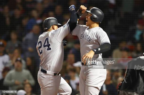 Gary Sanchez and Aaron Judge of the New York Yankees celebrate after Sanchez hit a threerun home run during the seventh inning of Game Two of the...