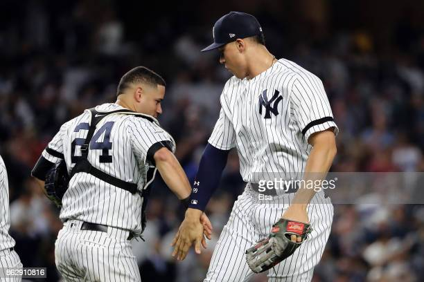 Gary Sanchez and Aaron Judge of the New York Yankees celebrate after defeating the Houston Astros in Game Five of the American League Championship...