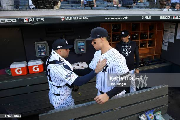 Gary Sanchez and Aaron Judge of the New York Yankees get ready in the dugout prior to Game 3 of the ALCS between the Houston Astros and the New York...