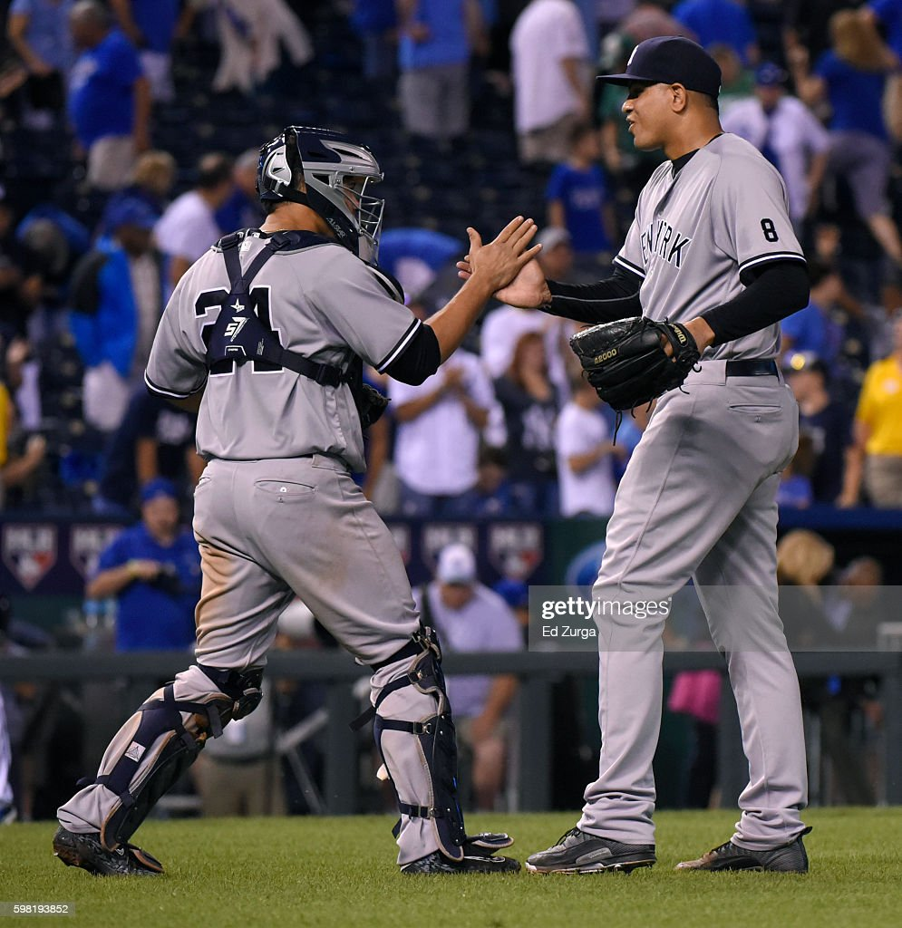 Gary Sanchez #24 and Dellin Betances #68 of the New York Yankees celebrate a 5-4 win against the Kansas City Royals in 13 inning at Kauffman Stadium on August 31, 2016 in Kansas City, Missouri.