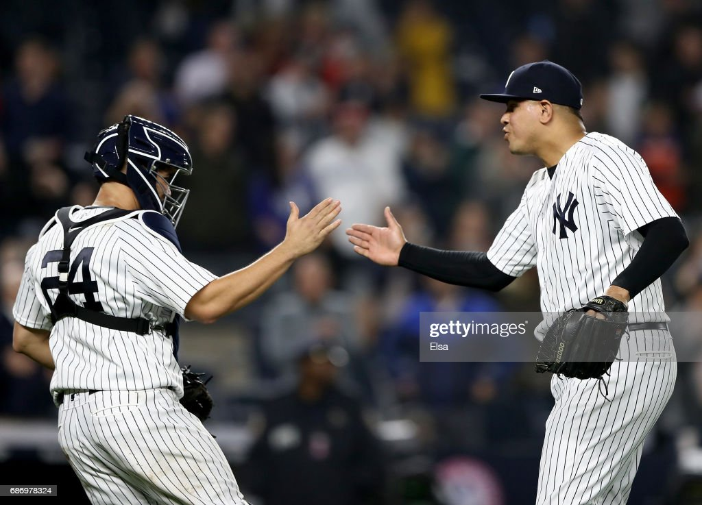 Gary Sanchez #24 and Dellin Betances #68 of the New York Yankees celebrate the 4-2 win over the Kansas City Royals on May 22, 2017 at Yankee Stadium in the Bronx borough of New York City.