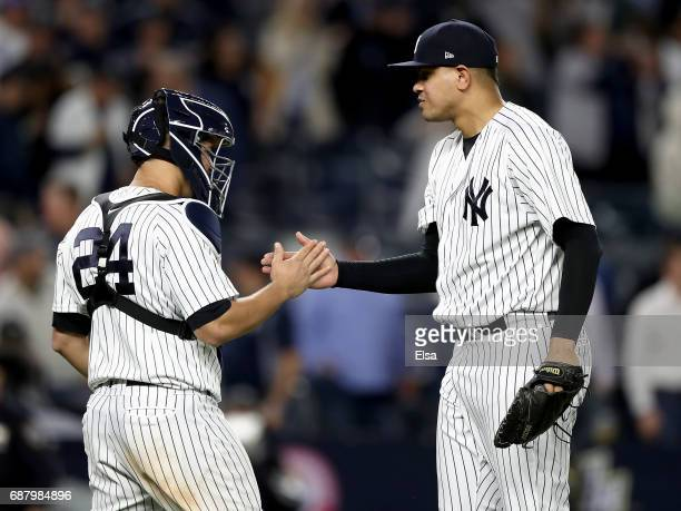 Gary Sanchez and Dellin Betances of the New York Yankees celebrate the 30 win over the Kansas City Royals on May 24 2017 at Yankee Stadium in the...