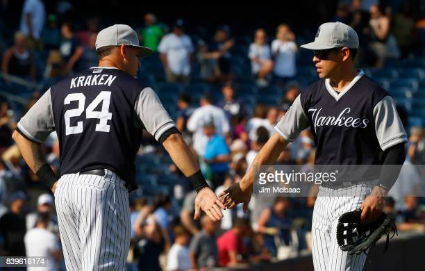Gary Sanchez and Jacoby Ellsbury of the New York Yankees celebrate after defeateing the Seattle Mariners at Yankee Stadium on August 26 2017 in the...