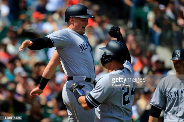 Gary Sanchez of the New York Yankees celebrates a grand slam with Luke Voit during the fifth inning against the San Francisco Giants at Oracle Park...