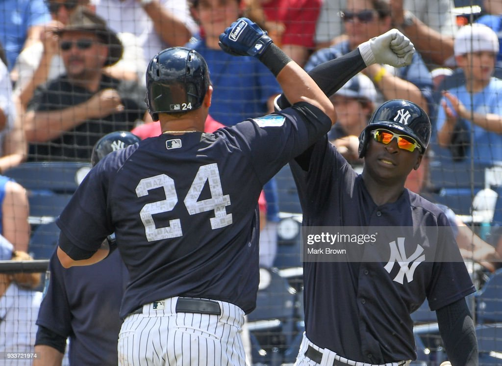 Gary Sanchez #24 of the New York Yankees celebrates a homerun in the third inning with Didi Gregorius #18 during the spring training game between the New York Yankees and the Miami Marlins at George M. Steinbrenner Field on March 18, 2018 in Tampa, Florida.