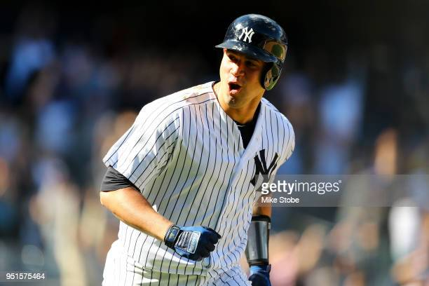 Gary Sanchez of the New York Yankees celebrates after hitting a walkoff three run home run in the bottom of the ninth inning against the Minnesota...