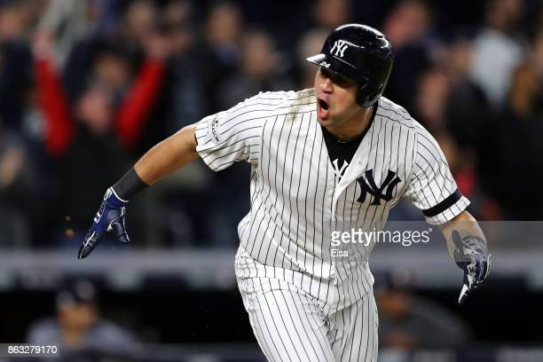 Gary Sanchez of the New York Yankees celebrates after hitting a two run double in the eighth inning against the Houston Astros during Game Four of...