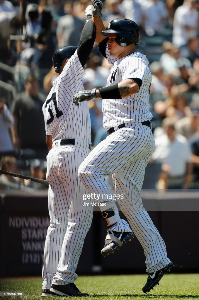 Gary Sanchez #24 of the New York Yankees celebrates his fifth inning home run against the Tampa Bay Rays with teammate Aaron Hicks #31 at Yankee Stadium on June 16, 2018 in the Bronx borough of New York City.