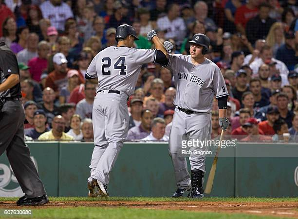 Gary Sanchez of the New York Yankees celebrates his home run with teammate Billy Butler during the third inning against the Boston Red Sox at Fenway...