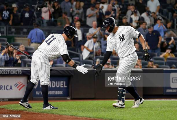 Gary Sanchez of the New York Yankees celebrates his second inning home run against the Texas Rangers with teammate Brett Gardner at Yankee Stadium on...