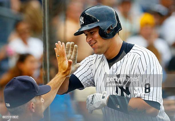 Gary Sanchez of the New York Yankees celebrates his sixth inning home run against the Tampa Bay Rays at Yankee Stadium on September 10 2016 in the...