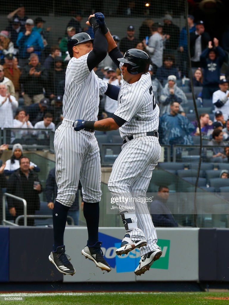 Gary Sanchez #24 of the New York Yankees celebrates his third inning two run home run against the Tampa Bay Rays with teammate Aaron Judge #99 at Yankee Stadium on April 4, 2018 in the Bronx borough of New York City.