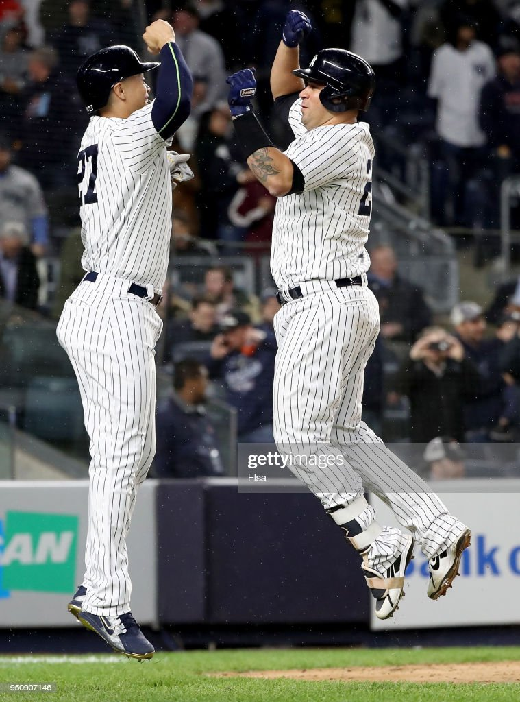 Gary Sanchez #24 of the New York Yankees celebrates his two run home run with teamamte Giancarlo Stanton #27 in the seventh inning against the Minnesota Twins at Yankee Stadium on April 24, 2018 in the Bronx borough of New York City.Sanchez drove them both home on the play.
