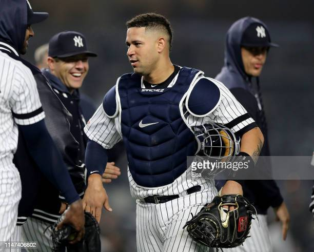 Gary Sanchez of the New York Yankees celebrates the win with teammates after the game against the Minnesota Twins at Yankee Stadium on May 03 2019 in...