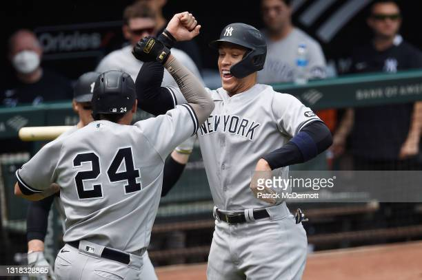 Gary Sanchez of the New York Yankees celebrates with Aaron Judge after hitting a two-run home run against the Baltimore Orioles in the first inning...