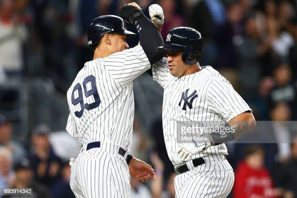 Gary Sanchez of the New York Yankees celebrates with Aaron Judge after connecting on a 3run home run in the third inning against the Boston Red Sox...