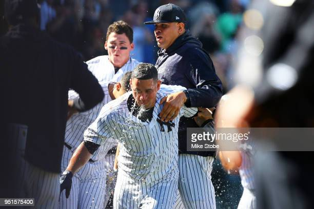 Gary Sanchez of the New York Yankees celebrates with Dellin Betances after hitting a walkoff three run home run in the bottom of the ninth inning...