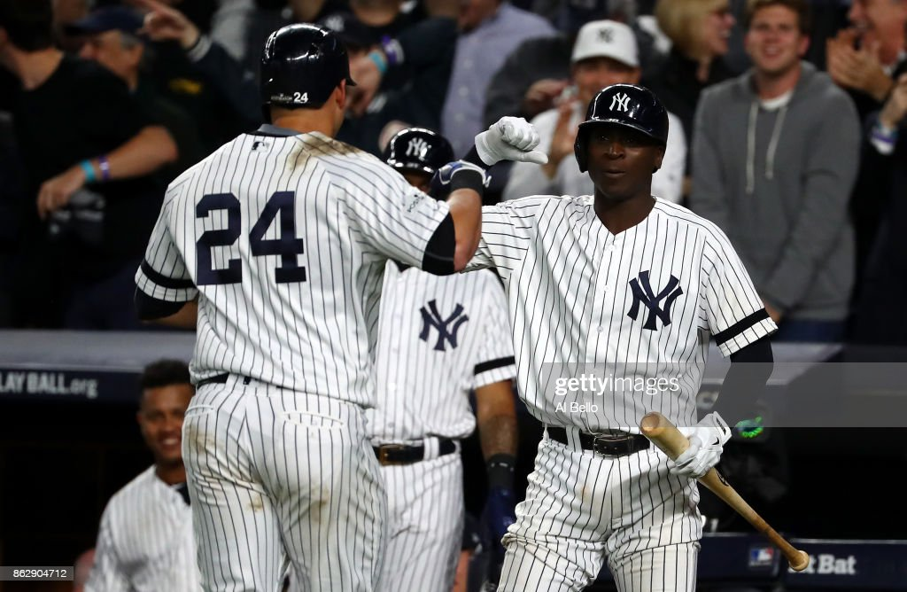 Gary Sanchez #24 of the New York Yankees celebrates with Didi Gregorius #18 after a solo home run during the seventh inning against the Houston Astros in Game Five of the American League Championship Series at Yankee Stadium on October 18, 2017 in the Bronx borough of New York City.