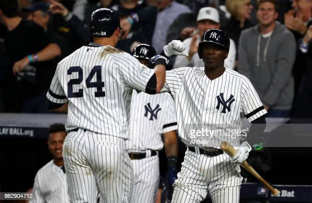 Gary Sanchez of the New York Yankees celebrates with Didi Gregorius after a solo home run during the seventh inning against the Houston Astros in...