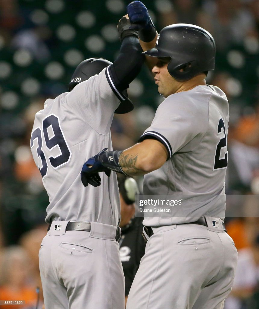 Gary Sanchez #24 of the New York Yankees celebrates with Tyler Wade #39 of the New York Yankees after hitting a two-run home run against the Detroit Tigers during the ninth inning at Comerica Park on August 22, 2017 in Detroit, Michigan. The Yankees defeated the Tigers 13-4.