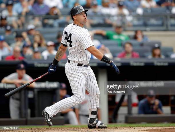 Gary Sanchez of the New York Yankees hits a home run in an MLB baseball game against the Boston Red Sox on August 12 2017 at Yankee Stadium in the...