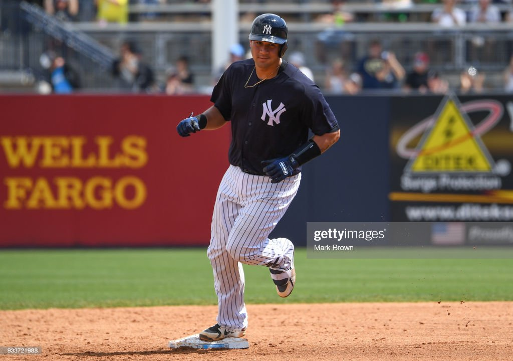 Gary Sanchez #24 of the New York Yankees hits a homerun in the third inning during the spring training game between the New York Yankees and the Miami Marlins at George M. Steinbrenner Field on March 18, 2018 in Tampa, Florida.
