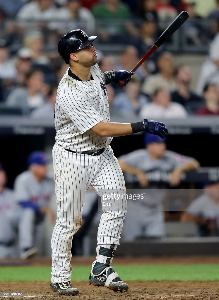 Gary Sanchez #24 of the New York Yankees hits a sacrifice fly in the eighth inning against the New York Mets during interleague play on August 15, 2017 at Yankee Stadium in the Bronx borough of New York City.Aaron Judge of the New York Yankees scored on the play.
