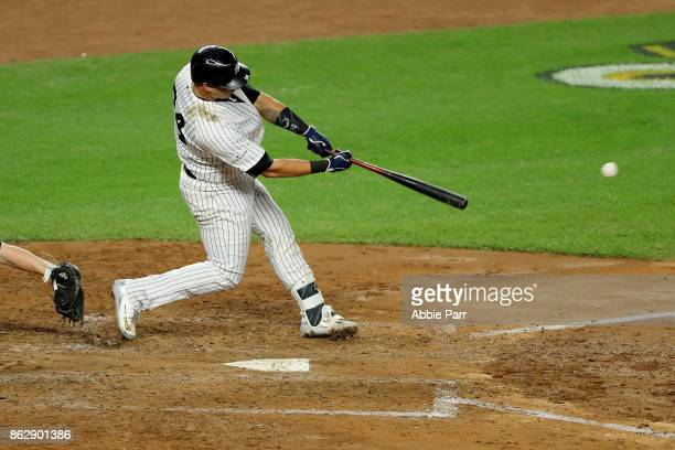 Gary Sanchez of the New York Yankees hits a single scoring Aaron Judge during the fifth inning against the Houston Astros in Game Five of the...