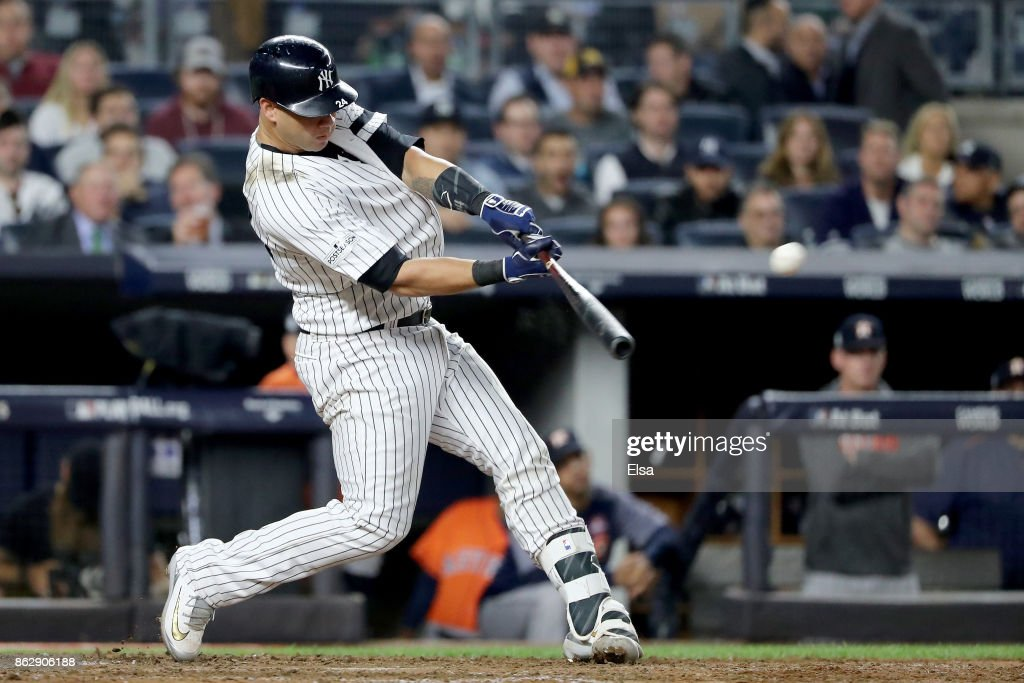 Gary Sanchez #24 of the New York Yankees hits a solo home run during the seventh inning against the Houston Astros in Game Five of the American League Championship Series at Yankee Stadium on October 18, 2017 in the Bronx borough of New York City.