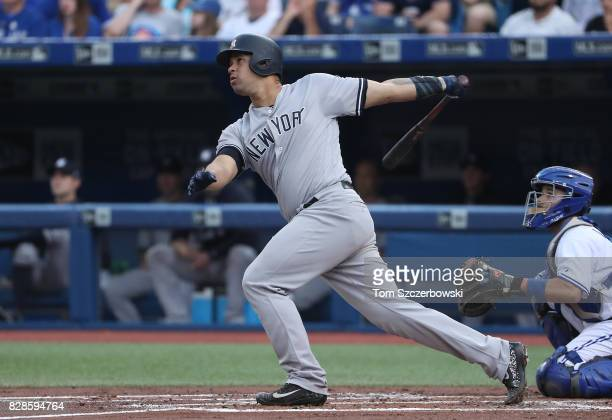 Gary Sanchez of the New York Yankees hits a solo home run in the second inning during MLB game action against the Toronto Blue Jays at Rogers Centre...