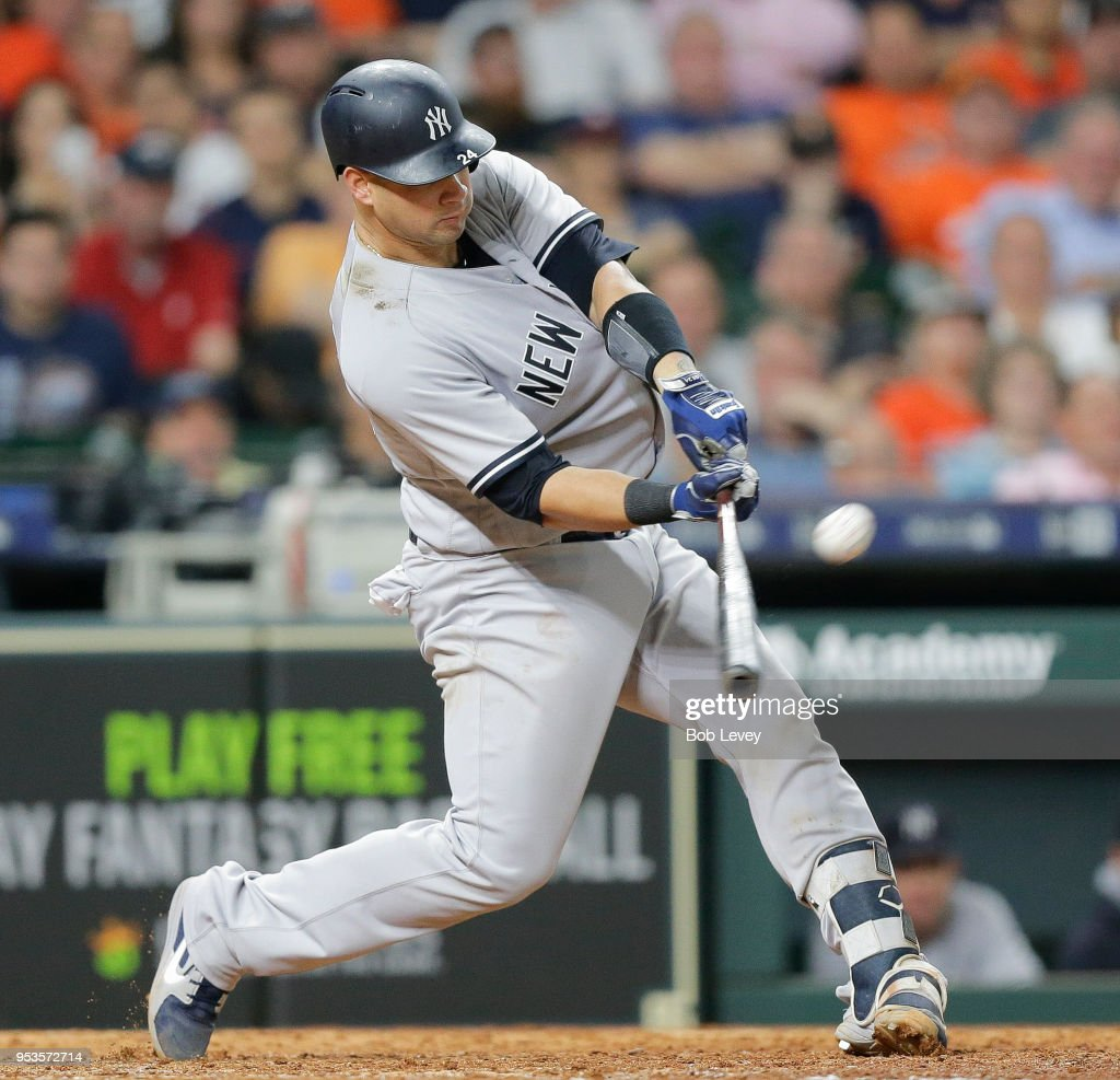 Gary Sanchez #24 of the New York Yankees hits a three-run home run in the ninth inning against the Houston Astros at Minute Maid Park on May 1, 2018 in Houston, Texas.