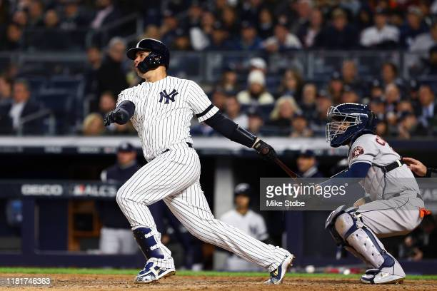 Gary Sanchez of the New York Yankees hits a tworun home run against the Houston Astros during the sixth inning in game four of the American League...