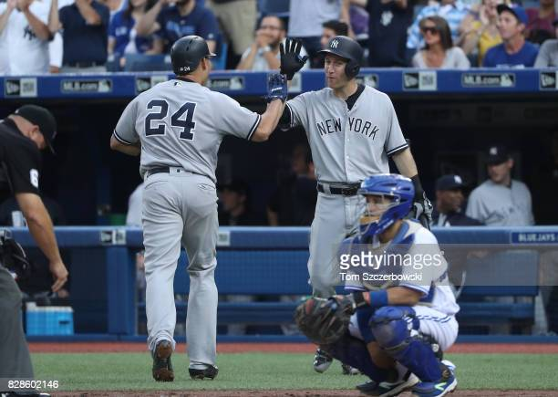 Gary Sanchez of the New York Yankees is congratulated by Todd Frazier after hitting a solo home run in the second inning during MLB game action...