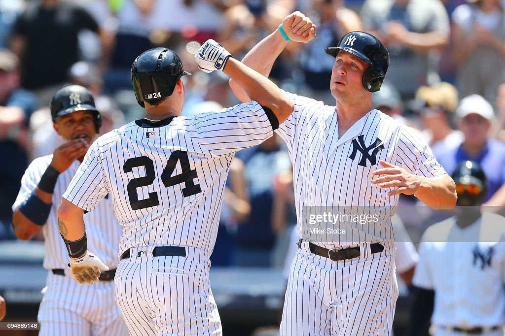 Gary Sanchez #24 of the New York Yankees is greeted by Matt Holliday #17 after connecting on a 3-run home run in the first inning against the Baltimore Orioles at Yankee Stadium on June 11, 2017 in the Bronx borough of New York City.