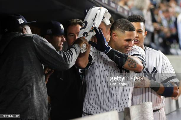 Gary Sanchez of the New York Yankees is greeted by teammates after hitting a solo home run in the seventh inning during Game 5 of the American League...