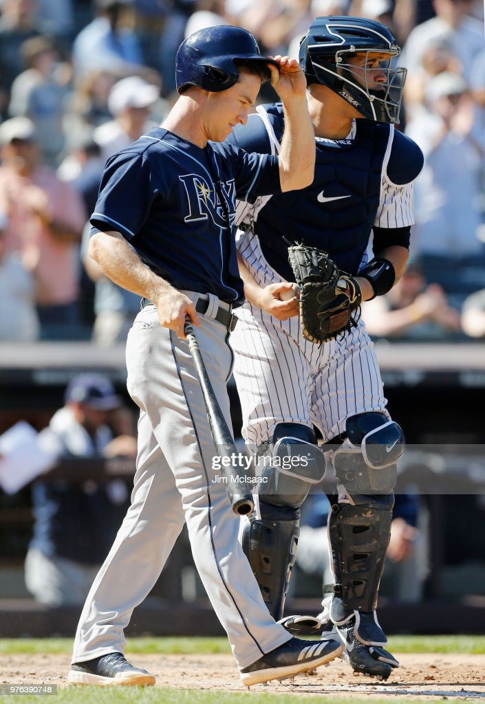 Gary Sanchez #24 of the New York Yankees looks on as Joey Wendle #18 of the Tampa Bay Rays reacts after striking out to end their game at Yankee Stadium on June 16, 2018 in the Bronx borough of New York City.