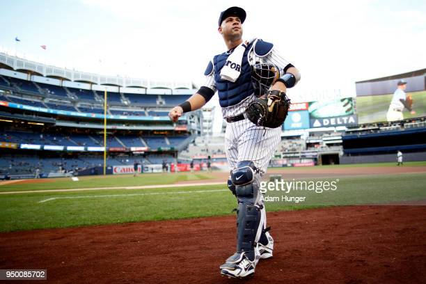 Gary Sanchez of the New York Yankees looks on prior a game against the Toronto Blue Jays at Yankee Stadium on April 19 2018 in the Bronx borough of...