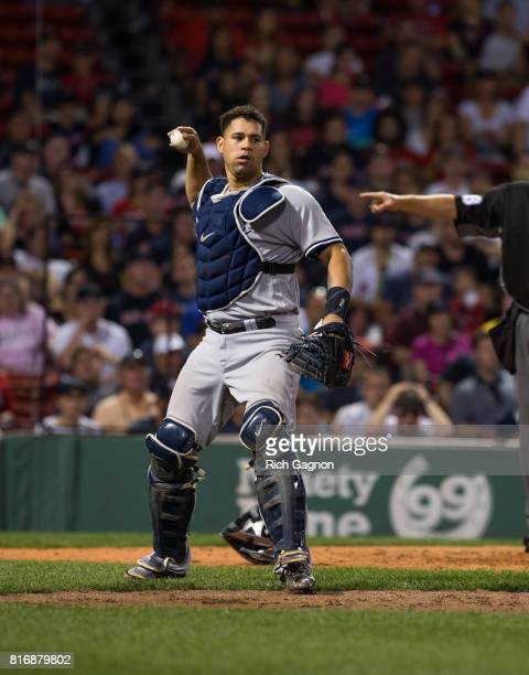 Gary Sanchez of the New York Yankees motions to throw the ball to first base during the fifteenth inning of a game against the Boston Red Sox at...