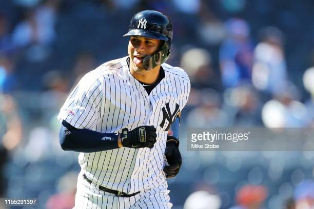 Gary Sanchez of the New York Yankees reacts after hitting a two-run home run to left field in the eighth inning against the New York Mets at Yankee...