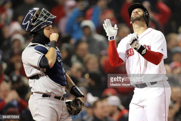 Gary Sanchez of the New York Yankees reacts as JD Martinez of the Boston Red Sox celebrates his grand slam during the fifth inning at Fenway Park on...