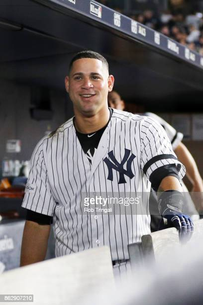 Gary Sanchez of the New York Yankees reacts in the dugout after hitting a solo home run in the seventh inning during Game 5 of the American League...