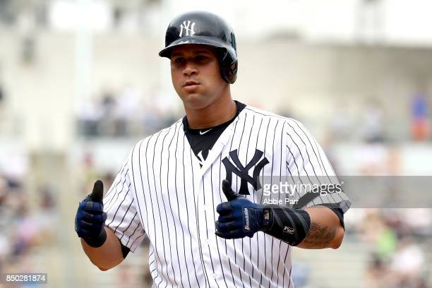 Gary Sanchez of the New York Yankees signals to the dugout after hitting an RBI single in the fifth inning against the Minnesota Twins on September...