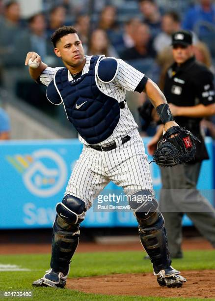 Gary Sanchez of the New York Yankees throws to first base in an MLB baseball game against the Tampa Bay Rays on July 27 2017 at Yankee Stadium in the...
