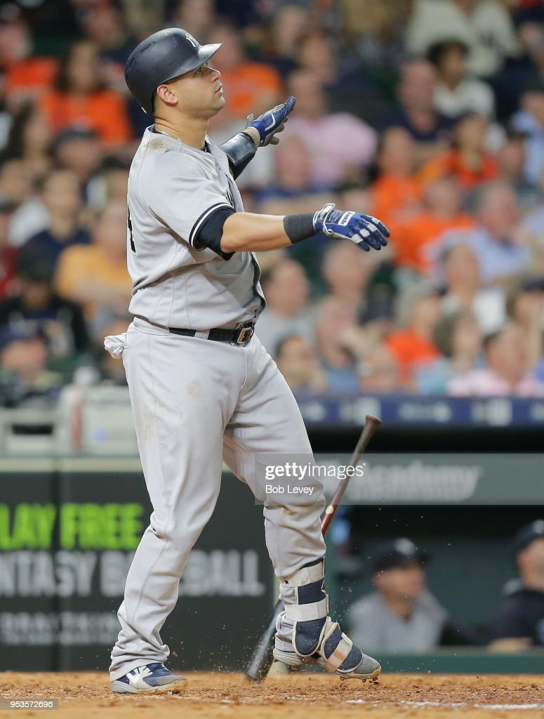 Gary Sanchez #24 of the New York Yankees watches his three-run home run leave the park in the ninth inning against the Houston Astros at Minute Maid Park on May 1, 2018 in Houston, Texas.